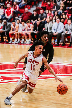 Jeffersonville's Jacob Jones makes his way down the court during the Red Devils' game against Ballard at Johnson Arena on Friday. Staff Photo By Josh Hicks