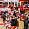 Jeffersonville's Jacob Jones attempts a lay up over Evansville's Elijah Dunham during the Red Devils' game against the Panthers at Johnson Arena on Friday. Staff Photo By Josh Hicks