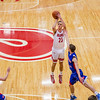 Jeffersonville's Gerrin Moore aims a three point shot during the Red Devils' game against Jennings County at Johnson Arena on Saturday. Staff Photo By Josh Hicks