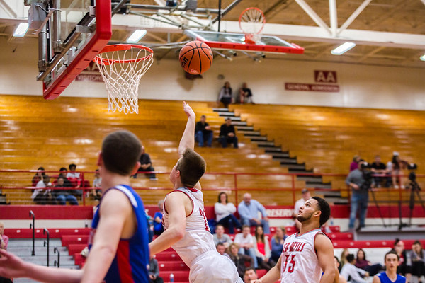 Jeffersonville's Bailey Falkenstein let's one fly over Cameron Northern during the Red Devils' game against Jennings County at Johnson Arena on Saturday. Staff Photo By Josh Hicks