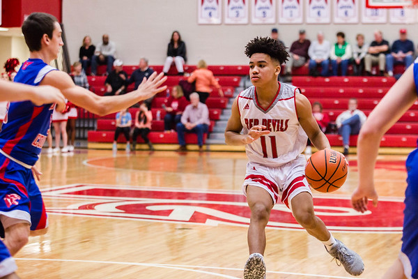 Jeffersonville's Jacob Jones faces off with Jennings County's defense during the Red Devils' game against the Panthers at Johnson Arena on Saturday. Staff Photo By Josh Hicks