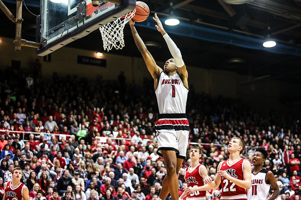 New Albany's Romeo Langford flys up to the rim during the Bulldogs' 89-52 Class 4A Sectional Semifinal win over Bedford at Lloyd E. Scott Gymnasium in Seymour on Friday. Staff Photo By Josh Hicks