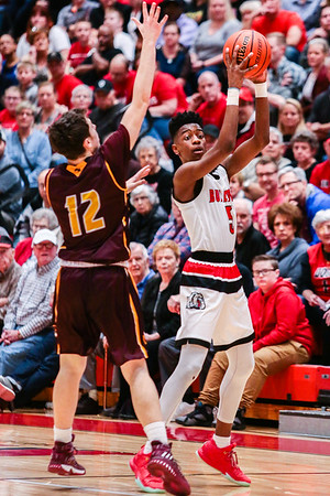 New Albany's Sean East looks for a pass during the Bulldogs' game against Bloomington North at the Doghouse on Friday. Staff Photo By Josh Hicks