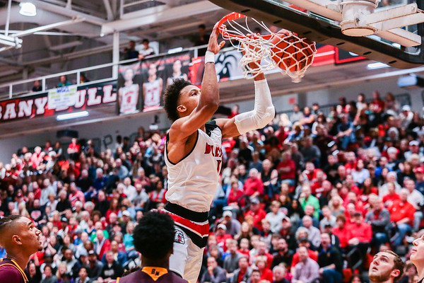 New Albany's Romeo Langford dunks the ball during the Bulldogs' game against Bloomington North at the Doghouse on Friday. Staff Photo By Josh Hicks