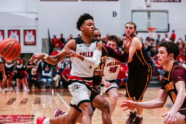New Albany's Romeo Langford sends a pass during the Bulldogs' game against Bloomington North at the Doghouse on Friday. Staff Photo By Josh Hicks