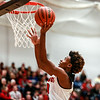 New Albany's Julien Hunter goes in for a lay up during the Bulldogs' game against the Jennings County Panthers at the Doghouse on Thursday. Staff Photo By Josh Hicks