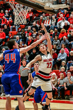 New Albany's Isaac Hibbard flings a hook shot past Jennings County's Tyler Vogel during the Bulldogs' game against the Panthers on Thursday. Staff Photo By Josh Hicks
