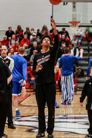 New Albany's Romeo Langford passes a ball in the air to himself with his good hand, while an injured pinkie on the other prevents him from playing in the Bulldogs' game against the Jennings County Panthers on Thursday. Staff Photo By Josh Hicks