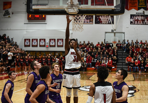 New Albany forward Julien Hunter gets the short-range jumpshot over Bloomington South defenders during the Bulldogs' 61-38 win over the Panthers on Saturday. Staff photo by Tyler Stewart