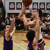 New Albany guard Isaac Hibbard pulls up for a shot over the Bloomington South defenders during the Bulldogs' 61-38 win over the Panthers on Saturday. Staff photo by Tyler Stewart