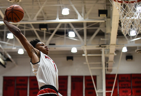 New Albany forward Romeo Langford floats toward the rim for a dunk over the Bloomington South defense during the Bulldogs' 61-38 win over the Panthers on Saturday. Staff photo by Tyler Stewart