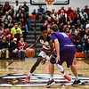 New Albany guard Sean Easton carries the ball up court as Bloomington South defender Phillip King pressures during the Bulldogs' 61-38 win over the Panthers on Saturday. Staff photo by Tyler Stewart