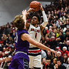 New Albany's Romeo Langford takes a 3-pointer over Bloomington South's Chris Bomba during the Bulldogs' 61-38 win over the Panthers on Saturday. Staff photo by Tyler Stewart