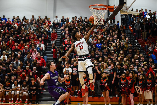 New Albany guard Savion Southers beats Bloomington South guard Luke Jager to the basket during the Bulldogs' 61-38 win over the Panthers on Saturday. Staff photo by Tyler Stewart