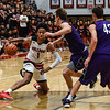 New Albany forward Romeo Langford cuts back on the Bloomington South defender before pulling up for a shot during the Bulldogs' 61-38 win over the Panthers on Saturday. Staff photo by Tyler Stewart