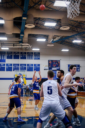 New Washington's Zach Moore nails a three-pointer during the Mustangs' 53-47 Class A Sectional win over the Christian Academy at NWHS on Saturday. Staff Photo By Josh Hicks