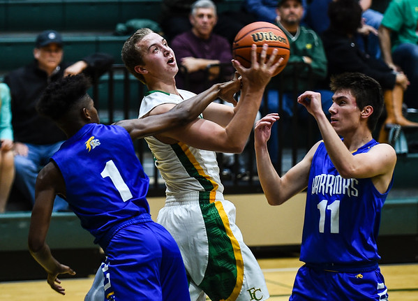 Floyd Central guard Tyler Kimm draws a foul from the Christian Academy defenders during the Highlanders' 65-28 win over the Warriors on Monday. Staff photo by Tyler Stewart