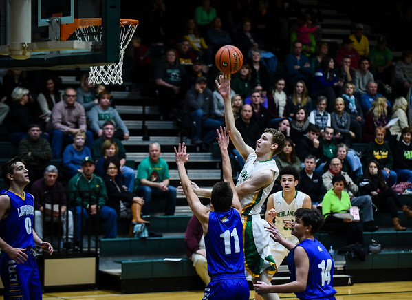 Floyd Central center Trevor Apple puts up a shot over the Christian Academy defense during the Highlanders' 65-28 win over the Warriors on Monday. Staff photo by Tyler Stewart