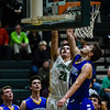 Floyd Central forward Cobie Barnes gets a layup over Christian Academy defender Stephen Cook during the Highlanders' 65-28 win over the Warriors on Monday. Staff photo by Tyler Stewart