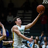 Floyd Central forward Luke Gohmann beats Christian Academy defender Patrick Fitzgibbons for a layup during the Highlanders' 65-28 win over the Warriors on Monday. Staff photo by Tyler Stewart