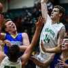 Christian Academy forward Riley Linnehan drives into the Floyd Central defense during the Highlanders' 65-28 win over the Warriors on Monday. Staff photo by Tyler Stewart
