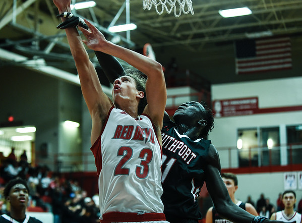 Jeffersonville forward Gerrin Moore beats Southport center Dut Mabok to the basket for a layup during the Red Devils' 65-52 win over the Cardinals on Wednesday. Staff photo by Tyler Stewart