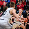 Providence's Sam Conrad looks to Juston Betz for a pass during the Pioneers' game against Brownstown Central at the Larkin Center on Saturday. Staff Photo By Josh Hicks