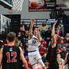 Providence's Dawson Mitchell makes a quick jump shot during the Pioneers' game against Brownstown Central at the Larkin Center on Saturday. Staff Photo By Josh Hicks