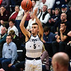 Providence's Cullen Ebert scores a three-pointer during the Pioneers' game against Brownstown Central at the Larkin Center on Saturday. Staff Photo By Josh Hicks