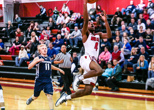 Rock Creek's Terrance Browning flies in for a lay up during the Lions' game against Providence at Restoration Christian Church on Tuesday. Staff Photo By Josh Hicks