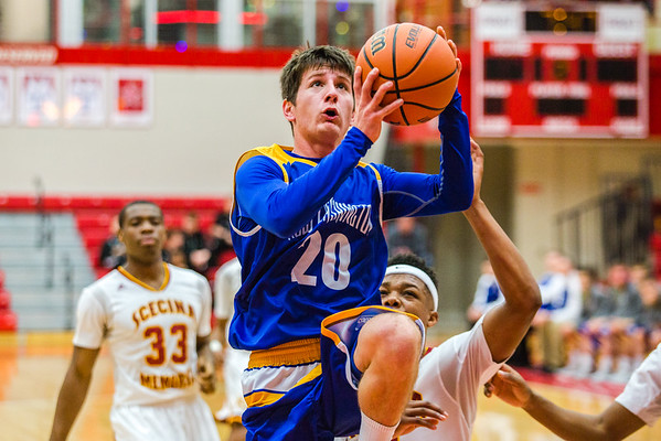 New Washington's Brandon Horton breaks free down center court and flies up to the basket during the inaugural Ted Throckmorton Memorial Tournament at Jeffersonville High School on Tuesday. Staff Photo By Josh Hicks