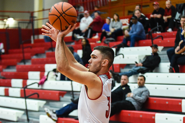 Jeffersonville forward Michael Minton takes a 3-pointer during the Red Devils' win over Christian Academy on Wednesday in the Ted Throckmorton Tournament. Staff photo by Tyler Stewart