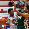 Jeffersonville forward Tre Coleman passes the ball around Northeastern's Freeman Brou during the Red Devils' 68-59 win over the Knights in the Ted Throckmorton Tournament. Staff photo by Tyler Stewart
