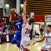 Christian Academy guard Noah Williams attempts a layup with pressure by Jeffersonville's Joe LaGrange during the Red Devils' win over the Warriors on Wednesday in the Ted Throckmorton Tournament. Staff photo by Tyler Stewart