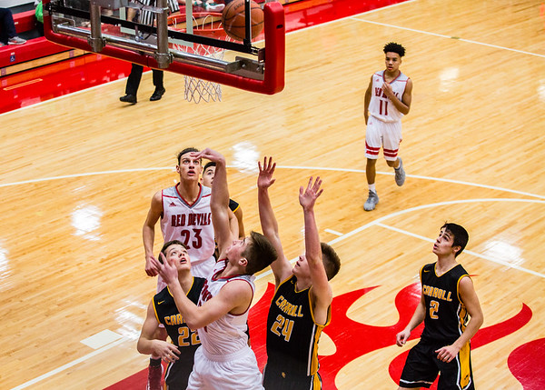 Jeffersonville's Bailey Falkenstein puts a rebound back up to the hoop, drawing extra anticipation in the opening round of the inaugural Ted Throckmorton Memorial Tournament at Johnson Arena in Jeffersonville. Staff Photo By Josh Hicks
