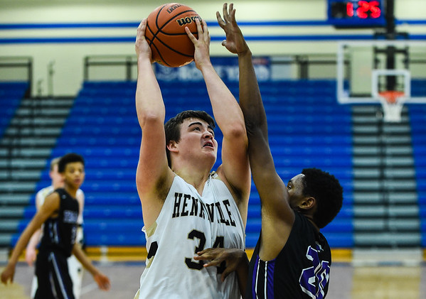 Henryville forward Thomas Green draws a foul on Louisville Southern's center Ecward Johnson during the Pirates' win over the Trojans in Wednesday's Ted Throckmorton Tournament. Staff photo by Tyler Stewart