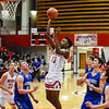 Jeffersonville forward Tre Coleman puts up a short-range shot over the Christian Academy defense during the Red Devils' win over the Warriors on Wednesday in the Ted Throckmorton Tournament. Staff photo by Tyler Stewart