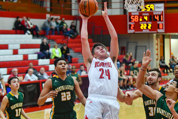 Jeffersonville forward Bailey Falkenstein gets the layup over the Northeastern defense during the Red Devils' 68-59 win over the Knights in the Ted Throckmorton Tournament. Staff photo by Tyler Stewart