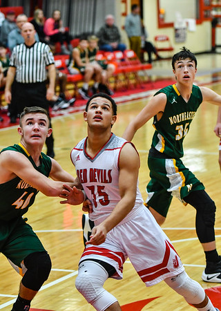 Jeffersonville forward Cameron Northern blocks out Northeastern's Alex Reynolds for a rebound during the Red Devils' 68-59 win over the Knights in the Ted Throckmorton Tournament. Staff photo by Tyler Stewart
