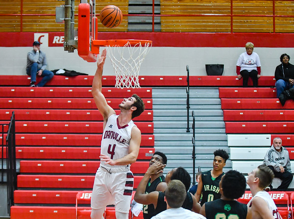 Danville guard Austin Cowart gets past the Cathedral defense for a layup during the Championship round of the Ted Throckmorton tournament on Thursday. Staff photo by Tyler Stewart