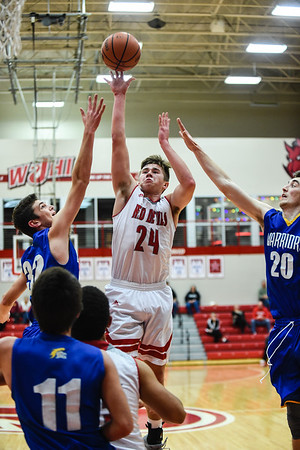 Jeffersonville forward Bailey Falkenstein puts up a short-range shot over the Christian Academy defense during the Red Devils' win over the Warriors on Wednesday in the Ted Throckmorton Tournament. Staff photo by Tyler Stewart