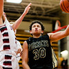 Nick Walker puts two points on the board for Henryville during round one of the inaugural Ted Throckmorton Memorial Tournament at Jeffersonville High School on Tuesday. The Hornets lost to Danville in double over time. Staff Photo By Josh Hicks