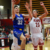 Christian Academy forward Bailey Conrad gets past Jeffersonville's Gerrin Moore for a layup during the Red Devils' win over the Warriors on Wednesday in the Ted Throckmorton Tournament. Staff photo by Tyler Stewart