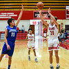 Jeffersonville guard Joe LaGrange pulls up for a 3-pointer over Christian Academy's Matt Hamby during the Red Devils' win over the Warriors on Wednesday in the Ted Throckmorton Tournament. Staff photo by Tyler Stewart