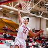 Jeffersonville's Gerrin Moore slams a dunk after sailing down an open court in the opening round of the inaugural Ted Throckmorton Memorial Tournament at Johnson Arena in Jeffersonville. Staff Photo By Josh Hicks