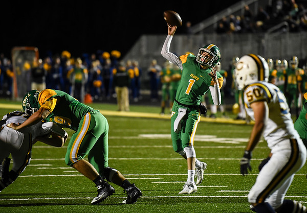 Floyd Central quarterback Matthew Weimer throws for a touchdown over the Castle defense during the Highlanders match against the Knights in the Regional Championship on Friday. Staff photo by Tyler Stewart