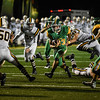 Floyd Central running back Jason Cundiff breaks a tackle by the Castle defender during the Highlanders match against the Knights in the Regional Championship on Friday. Staff photo by Tyler Stewart