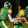 Floyd Central's Trace Willman takes the handoff from quarterback Matthew Weimer during the Highlanders match against Castle in the Regional Championship on Friday. Staff photo by Tyler Stewart
