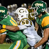 Floyd Central running back Zach Rodgers tries to fight through the tackle by Castle defender Freddie Coudret during the Highlanders match against the Knights in the Regional Championship on Friday. Staff photo by Tyler Stewart