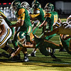 Floyd Central running back Jason Cundiff dives through the Castle defense for a touchdown during the Highlanders match against the Knights in the Regional Championship on Friday. Staff photo by Tyler Stewart